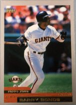 "Image of 2015.003.027 - Barry Bonds Baseball Card, 2000, Topps paper card.  The front of the card has an image of Bonds swinging a bat and wearing a white San Francisco Giants uniform with black and orange stripes.  He is also wearing a black batting helmet, black batting gloves and black elbow and wrist guards.  The front is bordered in grey.  Text on the front reads, ""TOPPS 2000 OUTFIELD BARRY BONDS"" and also contains Topps and the Giants' logos.  The back of the card has an image of Bonds wearing a black baseball cap with an orange ""SF"" and a black warm up jacket, also with an orange ""SF"".  Text on the back lists his statistics, achievements and biographical information.  Also contains MLB, MLBPA and Topps logos, as well as copyright information."