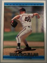 "Image of 2015.003.044B - Paul McClellan Baseball Card, 1991, Donruss paper card.  The front of the card has a picture of McClellan standing on a pitcher's mound pitching a ball.  His pitching arm is behind him.  He is wearing a white San Francisco Giants uniform, with black and orange stripes letters and numbers, and a black and orange cap and a black glove.  Text reads, ""PAUL McCLELLAN GIANTS PITCHER"".  The back of the card has an image of McClellan in the center wearing a white shirt and a black cap with orange interlocking 'SF'.  Text on the back describes his biographical information, statistics and accomplishments.  Also includes Donruss, MLB and MLBPA logos as well as copyright information."