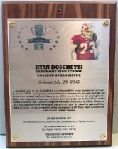 "Image of 2015.016.001 - Plaque commemorating Ryan Boschetti of Carlmont High School and College of San Mateo being inducted into the San Mateo County Sports Hall of Fame on July 23, 2015.  The plaque is silver acrylic mounted with golden screws onto a dark wooden base.  Plaque includes image of Boschetti wearing a burgundy Washington Redskins football uniform with the number ""73"" across the front in white outlined with yellow.  He is wearing a burgundy football helmet with a yellow facemask.  A brief biography is also on the front, ""A powerful force on the football field, Ryan Boschetti first made his mar at Carlmont  /  in the late 1900s.  An imposing defensive lineman blessed with size and strength, not  /  to mention competitive fire, he became an all-San Mateo County star playing for the  /  Scots, where he was a three-sport athlete.  Ryan proceeded on to the College of San  /  Mateo where he was a junior college all-American.  A standout at UCLA, he signed  /  as a free agent with the Washington Redskins in 2004.  He spent five years with the  /  Redskins.  Later, he was a member of the championship 2010 Las Vegas Locomotives  /  in the United Football League.""  The back of the plaque has an oval sticker with the logo and contact information for Spotlight Impressions, the manufacturer of the plaque."