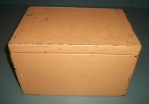 Image of 2000.021 - Yellow Metal Box, c. 1939-1945. Metal rectangular box with hinged lid that is painted yellow. The top of the box has a raised ledge that the lid sits on.