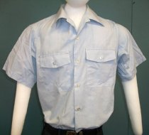 Image of 2015.025.031 - US Air Force Dress Shirt, c. 1952-1982.  Collared light blue-colored cotton/polyester short-sleeve dress shirt has two breast pockets with button-flap closures and a five-button closure down the front.  Buttons are clear plastic.