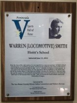 "Image of 2012.009.010 - Warren Smith Peninsula Sports Hall of Fame Plaque. Plaque commemorating Warren (Locomotive) Smith of Hoitt's School being inducted into Peninsula Sports Hall of Fame, sponsored by The San Mateo County/ Silicon Valley Convention and Visitors Bureau, on June 13, 2012. Plaque includes image of Smith and a brief biography: ""Near the close of the 19th century, he was regarded as a man among boys. At Hoitt's School in Burlingame, he excelled in all sports, becoming the California state Player of the Year in both football and track and field in 1897. At U.C. Berkeley, he lettered in three sports. At one point in his illustrious career, he was regarded as the top halfback on the West Coast. He led the Golden Bears to their first two football victories over Stanford in 1898 and 1899. He was the captain of Cal's football and baseball teams and scored points for the track and field teams in the hammer throw as well. Later, he became the head football coach at the University of Oregon."" Plaque is wood with an acrylic label attached to front with four screws, one in each corner. Wood has a hole in center top, as well as two grooves on back (one on the left and one on top below the hole), for mounting."