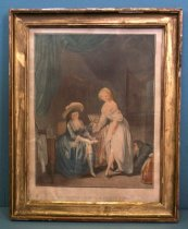 "Image of 2012.016.003 - Framed Intaglio Print, ""La Comparaison des Petits Pieds"", 18th-19th Cenury. Alexandre Chaponnier print after painting by Louis-Léopold Boilly. Color print shows two female figures in an interior room gazing at their feet. The figure on the left sits with her leg bent so that her right foot rests on her left knee. She wears a blue dress and a wide-brimmed hat. The female figure on the right wears a white dress that is open at the neck exposing her breasts. She lifts up her skirt with one hand and holds out her left foot slightly above the floor. At right, the door to the room is open and a male figure is visible crouched near the floor with his arms reaching under the white dress of the female figure. Large blue drapes appear in the top left corner of the image and there are several pieces of wood furniture with bottles and boxes in the background. ""LA COMPARAISON des PETITS PIEDS"" printed at bottom center below the image. Small text just below the left border reads, ""Boilly pt."" and at right, ""Chaponnier st."" Print frame is wood with gold painted surface."