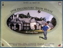 "Image of 2014.029.005 - Poster of 1998 Decorators' Show House of the Crosby Estate, 1998. Color poster, 18 x 24, with an overall background color of sage green. At the top of the poster in darker green print text reads, ""APRIL 26 - MAY 24."" Around the edges of the poster is a white border and breaking the line of the border is a picture in each corner. The top right hand picture is a painting of a woman wearing a hat and a white dress. In the lower right-hand corner is a picture of three red roses with three green leaves. In the upper left corner is a picture of an Oscar statue. In the lower left-hand corner there is a picture of an ornate chair. The chair has cupid and flower decorations on the cushion. A large oval appears at center outlined by two darker green lines. Above the oval in dark gray writing is, ""1998 DECORATORS' SHOW HOUSE."" Below the word 'SHOW' is a graphic of a black and yellow butterfly with motion lines. Inside the circle is a photograph of the Hillsborough Crosby estate that shows a white house with a gray roof. There is a lawn visible around the building. On the lawn in white cursive script is ""The Crosby Estate."" To the right inside the oval is an illustration of Bing Crosby wearing a brimmed hat and smoking a pipe.  He is wearing a light blue collared shirt, a darker blue sweater, gray pants, and golf shoes. His left arm is bent with his fist on his hip and he holds a golf club in his right hand. Crosby stands with his right leg over his left. The illustration of Crosby is printed over the photo of the estate at center with his lower legs outside of the oval on the background of the poster. Text at the bottom of the poster reads, ""BENEFITING THE COYOTE POINT MUSEUM  /  FOR ENVIRONMENTAL EDUCATION."""