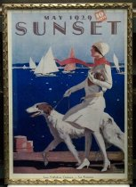 "Image of 2015.037.005 - Framed Color Poster, Sunset Magazine May 1929, c. 1929-2000. Poster of original magazine cover art that was printed at a later date and displayed in the Sunset Magazine offices. Offset color lithograph on paper shows an image of a woman walking a large dog on a pier by a deep blue body of water. The woman and dog appear in profile facing the left side of the image. The woman wears a white dress, gloves, hat, stockings, and shoes along with a red scarf and brown handbag. The dog has mostly white fur with a few brown patches. Red and white sail boats are visible in the background of the scene near the horizon line. Brown text along the top of the image reads, ""MAY 1929  /  SUNSET.""  White text, ""10  /  CENTS,"" appears in a small red rectangle printed at an angle above the 'E' in SUNSET. Artist's signature [illegible] appears in the bottom right corner. ""Lane Publishing Company ~ San Francisco"" is printed in small black text at bottom center below the poster image. The poster's frame is gilded wood with a pattern of three-dimensional curved decoration on all sides."