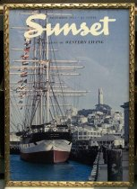 "Image of 2015.037.009 - Framed Color Poster, Sunset Magazine November 1957, c. 1957-2000. Poster of original magazine cover art that was printed at a later date and displayed in the Sunset Magazine offices. Offset lithograph on paper of a color photograph shows a large ship docked in San Francisco harbor with Coit tower and many buildings visible in the distance. Many flags fly from the ship masts including the American flag. The sides of the ship are painted with a red, white, and blue horizontal stripe, and ""BALCLUTHA  /  SAN FRANCISCO"" appears in yellow on the front of the ship. ""Sunset"" is printed in large white cursive font at top center and flanked above and below with small black text that reads, ""NOVEMBER 1957 * 25 CENTS"" and ""THE MAGAZINE OF WESTERN LIVING.""