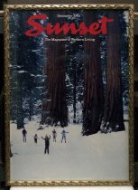 "Image of 2015.037.017 - Framed Color Poster, Sunset Magazine December 1981, c. 1981-2000. Poster of original magazine cover art that was printed at a later date and displayed in the Sunset Magazine offices. Offset lithograph of a color photograph on paper. The image shows a forest scene in winter with snow covering the ground, dusting the branches of pine trees, and visible at the bases of large redwood tree trunks. Five people are cross-country skiing at lower left. One person is closer to the viewer and the other four appear further back in the distance. ""Sunset"" is printed over the image in large red cursive font at top center. Small white text above and below ""Sunset"" at top reads, ""December 1981"" and ""The Magazine of Western Living."" The poster's frame is gilded wood with a pattern of three-dimensional curved decoration on all sides."