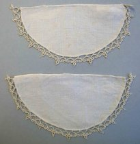 Image of 0002.229.009-010 - Dresser Scarves, n.d. Pair of half circle dresser scarves with tatted lace edging. No decoration to the half circle panels of fabric. The tatted lace edging is attached to the curved edge only with hand stitching. The lace has a pattern of loops and circles.