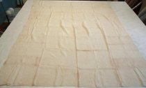 "Image of 1973.260.001 - Hand-loomed Linen Bedsheet, c. 1865-1873. Creme colored hand-loomed linen bedsheet has a selvage edge on the sides with a hem at top and bottom. Top left corner there is a 1in by 1.625in light brown cross stitch embroidery, ""S+C / 2"". Hand-loomed linen was woven in two sections 36in each and sewn together creating a vertical seam down the center."