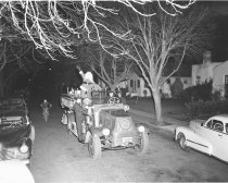 Image of 2015.001.00106 - Santa on Firetruck Driving in Burlingame, 1948