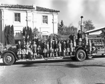 Image of Burlingame Girl Scout Troop on Fire Truck at Burlingame Fire Dept., 1948