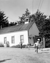 Image of Children Running Outside Coastside Schoolhouse, 1957