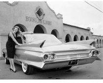 Image of 2015.001.01357.11 - Model Poses with Cadillac at Burlingame Southern Pacific Depot, 1960