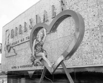 Image of Model Poses Inside Hillsdale Shopping Center Heart, 1960