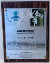 "Image of 2016.010.004 - Bob Keropian Peninsula Sports Hall of Fame Plaque, 2016.  Plaque commemorating Bob Keropian of El Camino High School being inducted into the Peninsula Sports Hall of Fame on June 8, 2016.  The plaque is printed on silver-colored metal with a 3"" x 2.5"" photograph mounted to the upper right hand corner.  Metal and photograph are mounted beneath acrylic with gold-colored decorative brads onto an mdf wooden base covered in a dark woodgrain vinyl laminate.  Top left corner has the 2016 Peninsula Hall of Fame logo which consists of a blue ribbon that reads  ""20  Peninsula Sports  16"" across the base of a green trophy whose base reads, ""HALL  /  OF  /  FAME"" with arcs of 7 blue stars on either side.  Black and white photograph shows Keropian dribbling a basketball down the court with a player in white running after him.  Keropian is in a darker colored uniform that includes shiny shorts, a tank top and dark high-top sneakers.  A brief biography is also on the front:  ""An outstanding high school and college athlete and four-sport letterman at San Francisco State, Bob Keropian has been president of the Northern California Chapter of the National Football Foundation and College Hall of Fame for the past 20 years.  During his tenure in that post, the foundation has distributed nearly $1.5 million in scholarship funds to Bay Area football players and donations to the athletic programs of North County high schools.  The founding principal of El Camino High in South San Francisco, Bob served as the school's chief executive for 29 years.  He received the NFF's National Leadership Award in 2004 and 2008.  He is a former South San Francisco Citizen of the Year.""  The back of the plaque has an oval sticker with the logo and contact information for Spotlight Impressions, the manufacturer of the plaque."