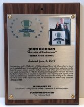 "Image of 2016.010.010 - John Horgan Peninsula Sports Hall of Fame Plaque, 2016.  Plaque commemorating John Horgan of Serra High School being inducted into the Peninsula Sports Hall of Fame on June 8, 2016.  The plaque is printed on silver-colored metal with a 3"" x 2.5"" photograph mounted to the upper right hand corner.  Metal and photograph are mounted beneath acrylic with gold-colored decorative brads onto an mdf wooden base covered in a dark woodgrain vinyl laminate.  Top left corner has the 2016 Peninsula Hall of Fame logo which consists of a blue ribbon that reads  ""20  Peninsula Sports  16"" across the base of a green trophy whose base reads, ""HALL  /  OF  /  FAME"" with arcs of 7 blue stars on either side.  Color image of Horgan behind the podium at a Peninsula Sports Hall of Fame ceremony.  A brief biography is also on the front:  ""John was born April 1, 1942 and is a 1960 graduate of Serra High School, where he played on the basketball team.  He attended both USF and San Francisco State, graduating from the latter.  He was an assistant coach for the Burlingame High School girls' basketball team the won a state championship in 1988.  His daughter, Jennifer, played on that team.  He worked for the San Mateo Times in a number of capacities-news reporter, sports reporter, sports editor and editorial page editor for 44 years prior to the 2008 downsizing.  He has continued to write a column for the paper since 2008.  He founded the San Mateo County Sports Hall of Fame in 1989.""  The back of the plaque has an oval sticker with the logo and contact information for Spotlight Impressions, the manufacturer of the plaque."