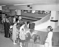 Image of 2015.001.02107.2 - United Airlines' New Baggage Claim Carousel at San Francisco International Airport, 1961