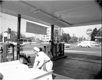 Image of Attendant Pumps Gas at Chevron Station, 1962