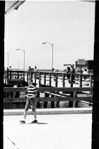 Image of 2015.001.05711.1 - Boy with Fishing Pole at Pacifica Pier, 1964