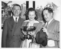 Image of 037 Kyne, Woman Holding Trophy, Man