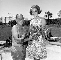 Image of 2015.001.07993 - Jose Ferrar with San Mateo Floral Fiesta Queen, 1965