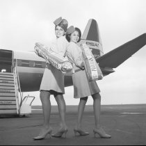 Image of 2015.001.10114. - Pacific Southwest Airlines Stewardesses Pose with Parisian Sourdough Bread, 1967