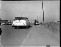 Image of San Carlos Police Officer Using New Radar Gun, 1958