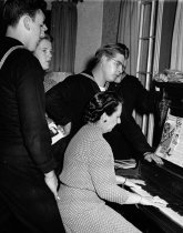 Image of 1970.039A.010 - Mrs. Pettingill Plays Piano at Tri Cities USO in San Mateo