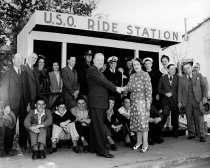 Image of 1970.039C.008 - Mrs. Pettingill at the USO Ride Station at El Camino & Third Avenue in San Mateo