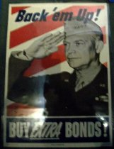"""Image of 1982.156.002 - Official US Treasury Poster, 1944. Poster in a white and red striped background with a man in uniform saluting. Above, bold blue text reads, """"Back' em Up!"""" At bottom, between a white border, the white bold text reads """"BUY EXTRA BONDS!"""". The word """"EXTRA"""" is underlined. Below the text above, in tiny, bold and blue, the printed text reads """"U.S. GOVERNMENT PRINTING OFFICE  :  1944--O-573054"""".  In the middle of the bottom of the front of the poster, in bold, the printed text reads """"OFFICIAL U.S. TREASURY POSTER"""". At the far right at the bottom of the poster, the printed text reads """"WFD 889"""".  Dimensions: 27 x 20"""