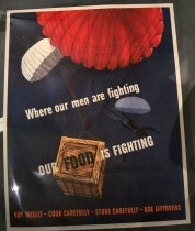 "Image of 1982.176.001 - WWII Poster, 1943. A white poster in a blue background with two men in two different colored parachutes, one white, and one blue, jumping down and a wooden crate connected to a red parachute on top near by the two men with parachutes.  There is some painted text on the blue background of the poster that says ""Where out men are fighting  /  OUR FOOD IS FIGHTING   /  BUY WISELY- COOK CAREFULLY- STORE CAREFULLY-USE LEFTOVERS."" On the very bottom of the poster, there is some more printed text that says ""OWI POSTER NO. 35.  Additional copies may be obtained upon request from the Division of Public Inquires, Office of War Information, Washington D.C.  /  U.S. GOVERNMENT PRINTING OFFICE : 1943-O-506016"". 