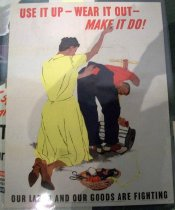 "Image of 1982.176.005 - WWII Poster of a woman stitching up a man's pants, 1943. A poster in a white background with a woman in yellow dress and brown shoes standing behind a man in a red shirt and blue pants that the woman is stitching with her hands with a needlepoint and red yarn as the man is holding on to the handle of his lawnmower in one hand, and the plug for the lawnmower in the other. Next to the woman and man, there is basket with a tape measurer, scissors, more yarn, and other accessories. Above the figures in the middle of the poster, in red and in bold, there is some painted text that reads ""USE IT UP - WEAR IT OUT -  /  MAKE IT DO!"". Below the figures in the middle of the poster, painted in black and in bold, there is some text that says ""OUR LABOR AND OUR GOODS ARE FIGHTING"". Below the text above, in tiny font, the printed text reads ""OWI Poster No. 39. Additional copies may be obtained upon request from the Division of Public Inquires, Office of War Information, Washington D.C."". Next to the text above, in black, bold with tiny lettering, the printed text reads ""U.S. GOVERNMENT PRINTING OFFICE : 1943-O-506726"".