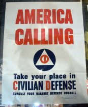 "Image of 1982.187.003A - Civil Defense WWII Poster, 1941. Poster in a white background with the Civil Defense insignia in the middle: a blue circle with a white triangle with the painted words ""CD"" in the middle. Above the Civil Defense insignia, painted in red, bold with huge lettering, the text says ""AMERICA  /  CALLING"". Below the Civil Defense insignia, painted in blue, bold with big lettering, the text reads ""Take your place in  / CIVILIAN DEFENSE  /  CONSULT YOUR NEAREST DEFENSE COUNCIL"" The ""C"" in the word ""CIVILIAN"" and ""D"" in the word ""DEFENSE"" are in red. The phrase ""CONSULT YOUR NEAREST DEFENSE COUNCIL"" is smaller than the rest of the text ""Take your place in  / CIVILIAN DEFENSE"" above it. Below all of the text above, printed in blue, bold and tiny lettering, the text says ""DIVISION OF INFORMATION, OFFICE FOR EMERGENCY MANAGEMENT  /  U.S. GOVERNMENT PRINTING OFFICE  :  1941--O-423671""