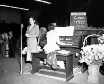 Image of Eunice Steele Playing Baldwin Organ in Burlingame, September 1948
