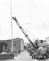 Image of Erecting New Flag Pole at Burlingame City Hall on Park Road, 1950