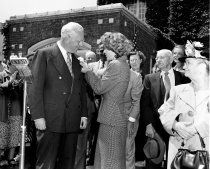 Image of 2015.001.00514.1 - Presenting a Boutonnière to Governor Earl Warren in Front of the Burlingame City Hall, October 1949
