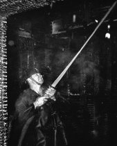 Image of 2015.001.00521.1 - Burlingame Firefighter Extinguishing a Fire, 1949