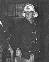 Image of 2015.001.00521.2 - Burlingame Assistant Fire Chief at Scene of a Fire, November 1949