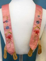 Image of 0000.228 - Men's Suspenders, c. 1860s. Pink silk with multicolored embroidered floral design with leather and elastic straps and metal button fasteners.