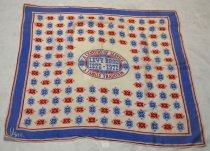 "Image of 2009.028.001 - Levy Bros Centennial Scarf, 1972. Square silk with a red, white and blue print. It has a blue border edged by red. In the middle of the scarf, there is oval shape with blue outside border with some bold and red text that says ""A CENTURY OF SERVICE  /  A FAMILY TRADITION"". It has a red inside border with the blue rectangular square with some blue and bold text that says ""LEVY BROS  /  1872-1972"". On the lower left hand corner of the scarf, there is a insignia in cursive and in white that says ""Vera"" with a small copyright insignia next to the text ""Vera""."
