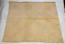 Image of 2010.171.015P - Napkin, c. 1920s. Square scarf in off-white or cream silk. Plain border with subtle repeating pattern of crosses and rectangles. Original notes mention that scarf may have been used as baby blanket.
