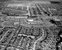 Image of 2015.001.00717.3 - Aerial Looking East of South San Mateo, Hillsdale Shopping Center, Bay Meadows Racetrack, and San Mateo Village Subdivision