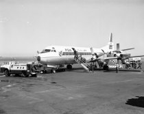 Image of Pacific Southwest Airlines Electra Jet with Passengers Disembarking on San