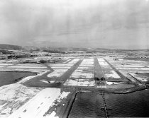 Image of 2015.001.02787.9 - Aerial of San Francisco International Airport Runway Covered with Snow, Looking West, 1962
