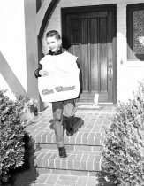 Image of San Mateo Times Paperboy Delivering Papers House to House, 1962
