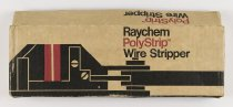 "Image of 2016.015.002.43 - Raychem PolyStrip Wire Stripper Kit, c. 1960s-1970s. This is a Raychem Corporation PolyStrip wire stripper device in its original cardboard box with two cartridges of replacement blades. (A) The PolyStrip wire stripper has two gray metal levers that are joined at a fulcrum to create pincers with a set of ""jaws"" with blades at one end and spring loaded handles at the other. Squeezing the handles closes the blades around a piece of inserted wire. The handles are covered with insulating black plastic, and the blades are made from red colored polyarylene plastic. Clear adhesive labels with ""Raychem"" in white lettering are applied on the top side of the stripper near the blades and on the bottom side near the fulcrum. The two cartridges included in the kit are circular containers made from clear plastic that hold up to 10 red 1"" x 0.25"" blades in a radiating fashion. Cartridge (B) has 10 blades and cartridge (C) contains 6 blades. The wire stripper and the cartridges rest inside an insert in the cardboard box that inhibits them from sliding around. The tan cardboard box (D) has a flip top with tabs for securing the lid. The top of the lid shows a red and black graphic of the PolyStrip tool with ""Raychem  /  PolyStrip (TM)  /  Wire Stripper"" printed in red and black font at upper right. ""PolyStrip (TM) Wire Stripper"" is printed on all four sides of the box. ""No. 959001"" appears on the sides of the box, and additional text on the back reads, ""Strips twisted pairs and ribbon cables  /  Can't nick or cut conductor  /  No adjustment for wire size or type.""