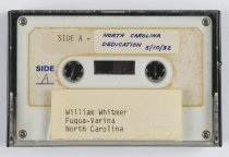 "Image of 2016.015.003.18 - Raychem Corporation Fuquay-Varina Dedication, May 10, 1982. White plastic audio cassette in a clear and black plastic case contains audio from the Raychem Corporation's dedication of the Fuquay-Varina Facility in North Carolina. A white rectangular label adhered to the top of both side A and side B has handwritten text in blue ink that reads, ""NORTH CAROLINA  /  DEDICATION 5/10/82."" The cassette also has company information printed in small blue font on both sides that reads, ""festival productions  /  849 East Charleston Rd., Palo Alto, CA 94303 (415) 494-9366."" A label on the outside of the case reads, ""William Whitmer  /  Fuqua-Varina [sic]  /  North Carolina."""