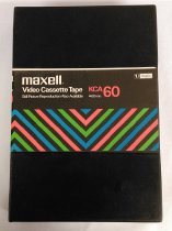 "Image of 2016.015.003.2 - Betalloy Training #2, 1978. Recording by the Raychem Corporation on a Maxell KCA 60 3/4"" U-matic videotape. NTSC encoding with unknown run time. Black plastic outer case has an attached plastic sleeve at center. A paper label with the manufacturer's information and a pattern of diagonal stripes in green, red, and blue on a black background is inserted into the sleeve. A paper label is adhered to the top of the cassette with the same graphic design and manufacturer's information. The label also contains information about the video recording filled in by hand in blue ballpoint pen. From top to bottom the inscription reads, ""BetAlloy [sic] Training #2  /  10/23/78  /  Peter Brooks Metals Technology  /  Dick Yaeger Bettaloy [sic] Product Dev."""