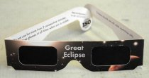"Image of 2017.048.002 - Great Eclipse Glasses, 2017. Cardboard glasses printed with an image of outer space on the outside frame. The front of the frame is rectangular, though the bridge is cut in the shape of a parabola for the nose. The image printed on the frame shows a reddish planet just below and to the side of the left lens; a bright light, presumably the Sun, is above the right lens. There are images of stars scattered around the frame of the glasses. The lenses are covered in a opaque black film and are small and have a rectangular shape. Right above the bridge is written ""Great  /  Eclipse."" The temples are large and rectangular with the only round edge being the temple tip. If the temples were to be held straight out the glasses would form one continuous line on the top with only the bottom portion having any variation in cut and design. On the right temple is written ""Aug. 21, 2017  /  The next total eclipse won't be until Apr. 8, 2024 or Aug. 21, 2045!"" The inside of the frames is white. On the inside of the right temple reads, ""Do not use for more than 3 consecutive minutes.  /  Use eclipse glasses at all times when sun is visible."" Just as the temple turns into the temple tip, it reads ""Meets the Requirement  /   for ISO 12312-2:2015."" On the temple tip there is a logo showing a globe with lines of longitude and latitude with bold, black letters printed over it, ""ISO."" On the inside of the left temple, it reads ""Children should use with adult supervision only."" On the left temple tip, there are stylized letters ""C E"" with the words ""Made in China"" printed below them."