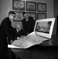 Image of 2015.001.03953C.8 - Cotton Family Looking at Renderings of Borel Place, San Mateo, January 1963
